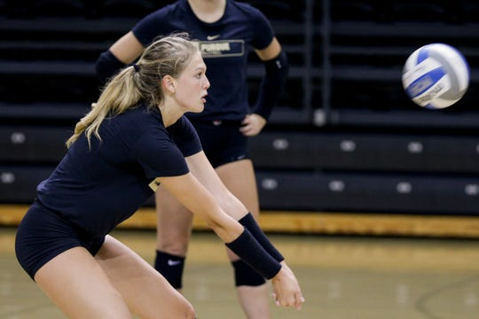 Purdue outside hitter Maddy Chinn (5) hits the ball during practice, Monday, Aug. 19, 2019 at Purdue University's Holloway Gymnasium in West Lafayette.