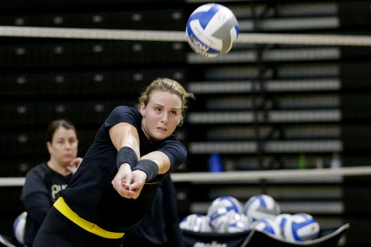 Purdue outside hitter Caitlyn Newton (4) returns the ball during a practice, Monday, Aug. 19, 2019 at Purdue University's Holloway Gymnasium in West Lafayette.