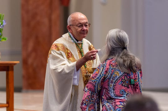 The most reverend J. Douglas Deshotel, D.D. Bishop of Lafayette celebrates Our Lady of Lourdes 70th Anniversary during mass at St. Pius Church in Lafayette, La., Tuesday, Aug. 20, 2019.