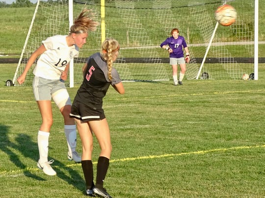 Lancaster senior Isabella Galecki heads the ball during a nonconfrence match against Fairfield Union.