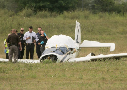 Investigators at the scene of an airplane crash at the Spencer J. Hardy Airport in Howell Tuesday, Aug. 20, 2019. The crash killed two people, James Tafralian, 68, of Webberville, and his passenger, Philip 'Flip' Colmer, 64, of Chelsea.   .