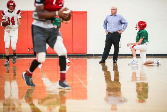 First-year Jeff football head coach Isaac Parker watches the beginning of an indoor practice recently. A 1999 Jeff grad, Parker says leading his alma mater means a lot to him -- and he's working on improving the students' grades as well with daily study sessions to improve academics.