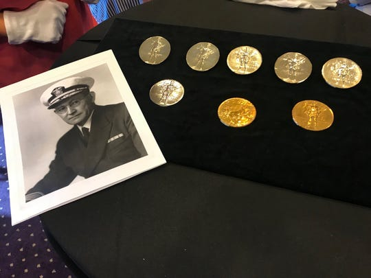 The late Admiral Willis Lee's Olympic medals from 1920. He earned five gold, one silver and one bronze. One medal (bottom row, center) is a participation medal.