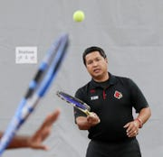UofL's tennis coach Rex Ecarma at the Bass Rudd Tennis Center.  September 27, 2018