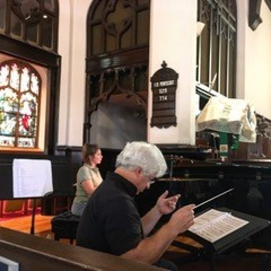 """Paul Chandley conducts rehearsal for the Mid-Ohio Opera company's upcoming performances of """"Carmen."""""""