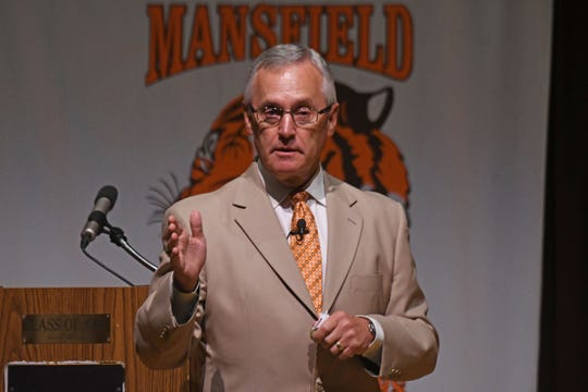Former Ohio State Football coach and current Youngstown State President Jim Tressel speaks to the Mansfield City Schools employees Tuesday morning.