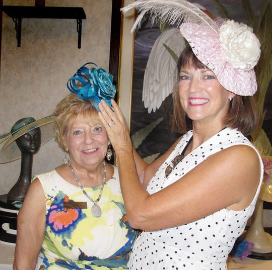 Diane adjusts a hat for Sue Winje.