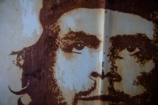 A 1962 Chevrolet car hood with a portrait of Che Guevara sits in Michael Stodola's garage. The brewery brand manager began experimenting with car hood art in 2010 when he wanted to test out a new medium of art.