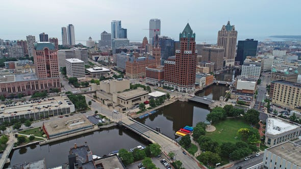 The Milwaukee River and downtown in Milwaukee on Tuesday, Aug. 20, 2019. - - Skyline city landscape development drone - .  Photo by Chelsey Lewis and Mike De Sisti/Milwaukee Journal Sentinel