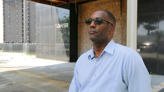 "Reggie Jackson, a prominent historian and consultant with Nurturing Diversity Partners, says Milwaukee has endured a ""perfect storm""  of economic downsizing in the last 50 years. He's standing in front of the old A.O. Smith autoworks, once the city's biggest industrial employer."