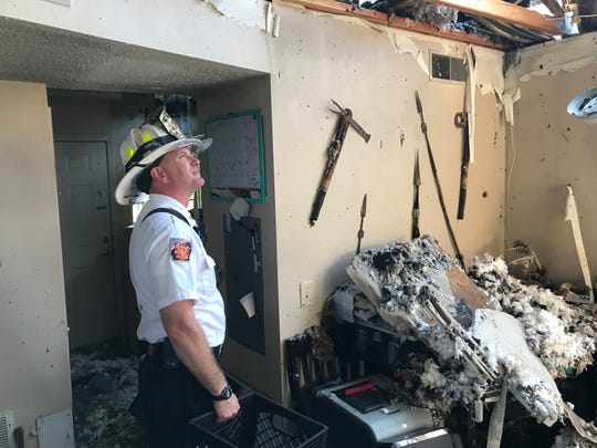 Gassville Fire Chief Michael Glotzl surveys some of the damage at Gassville Garden Apartments Tuesday as he prepares to gather belongings for one of the displaced residents. Glotzl said the cause of the blaze was under investigation by the Gassville Police Department.