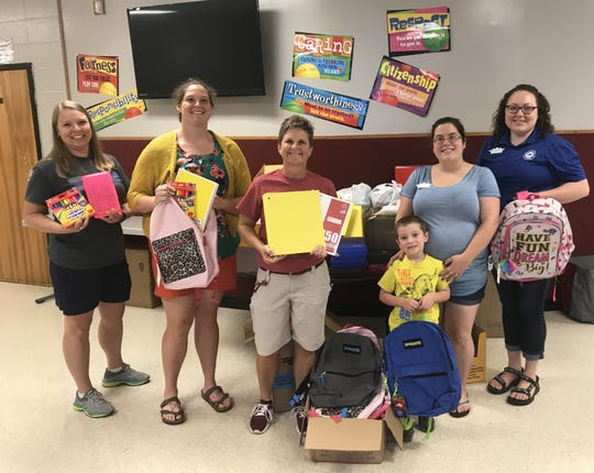 Junior Auxiliary of Mountain Home recently presented over 2,500 school supply items and 100 communication folders to Norfork Public Schools. Community donations at Junior Auxiliary's annual Stuff the Bus event allowed for the local chapter to purchase backpacks and additional supplies for students across Baxter County.