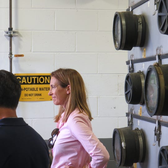 Rep. Mikie Sherrill (D-11th District)                                          listens to a report during a tour of EPA SUperfund sites in her district, this one at the Rockaway Township Well facility in Denville. August 20, 2019.