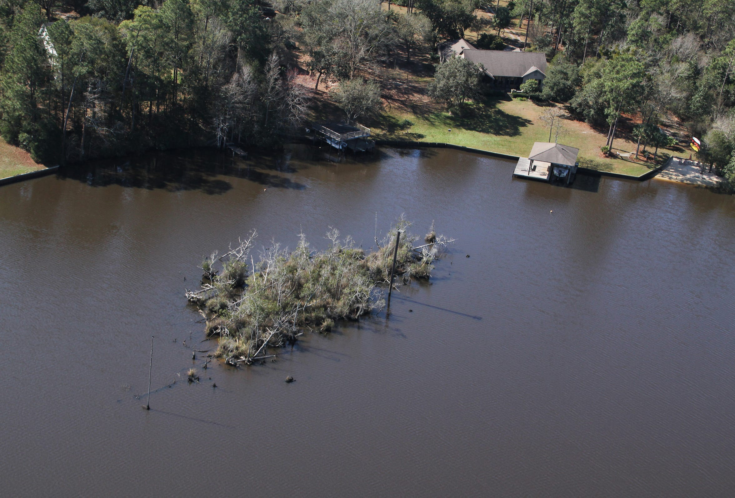 An island in the Fowl River near Theodore, Ala., that is disappearing.