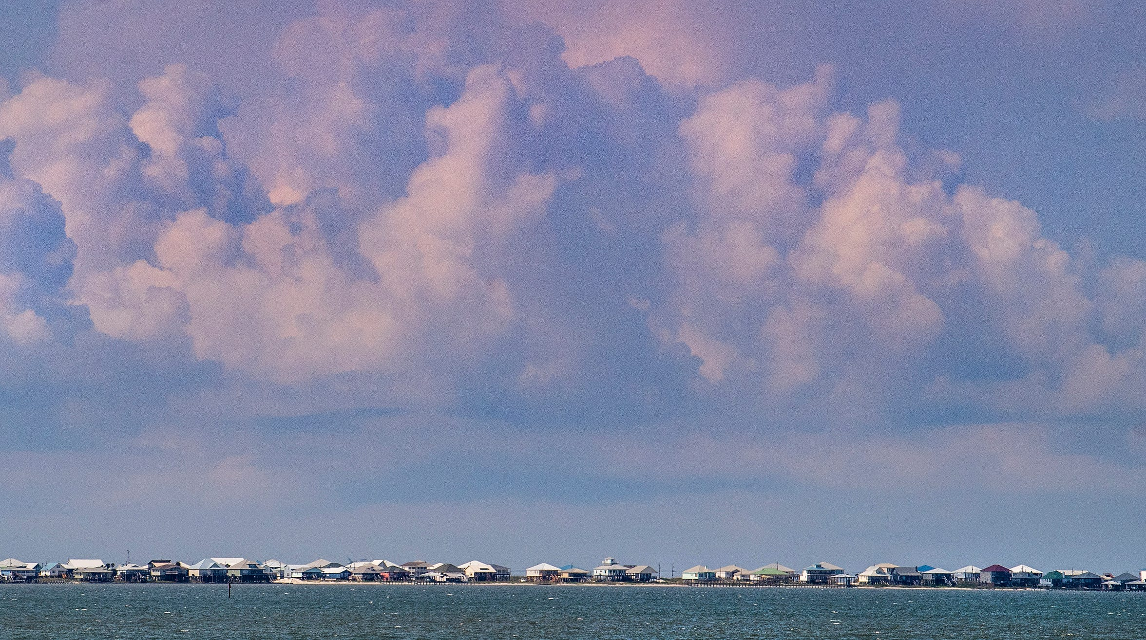 Beach houses on Dauphin Island, Ala., on Wednesday August 7, 2019.