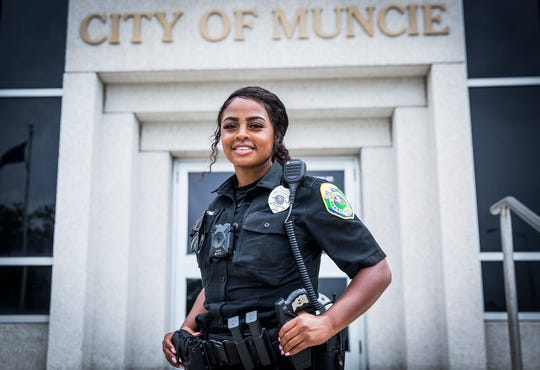 Officer Ty'Ronda Benning stands outside of City Hall.