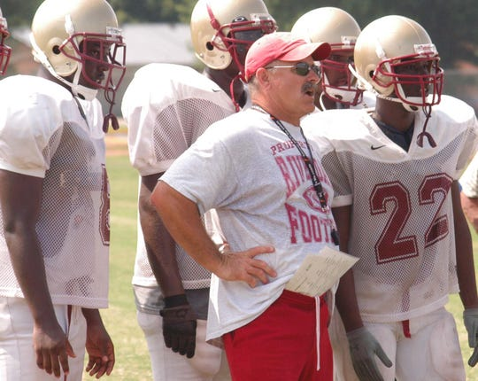 Former Riverdale football coach Gary Rankin leads the Warrior through a goal-line stand drill during a 2005 practice.