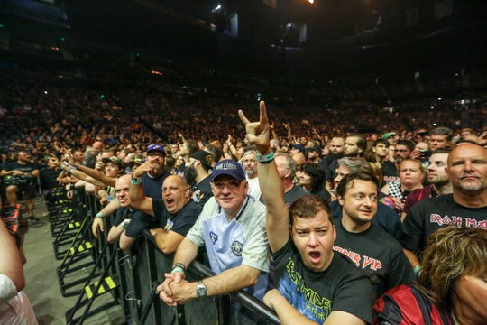Fans cheer as Iron Maiden plays on Aug. 19, 2019, at Bridgestone Arena in Nashville, Tennessee.