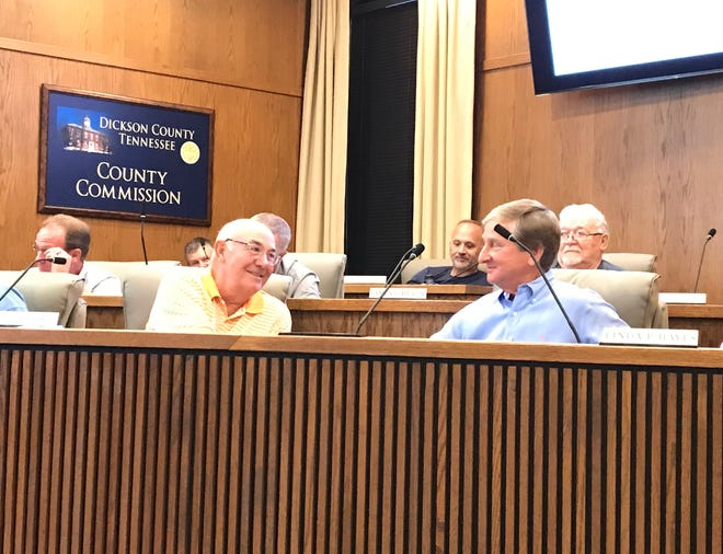 Newly-chosen county Commissioner Jeff Corlew, right, sits at the District 10 seat for the first time Monday night at the commission meeting.