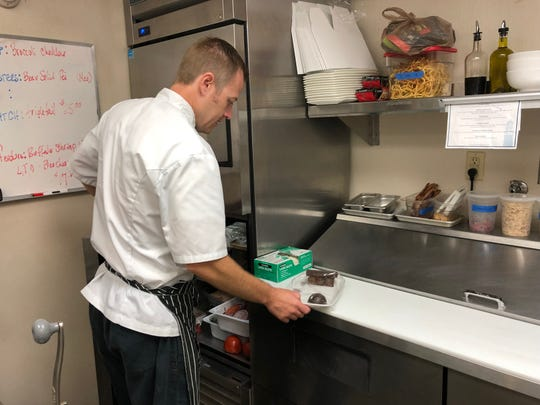 Hamilton Harbor Yacht Club's pastry chef, Sean Dwyer, picks a selection of desserts to begin preparing for dinner service at the club on Thursday, July 25.
