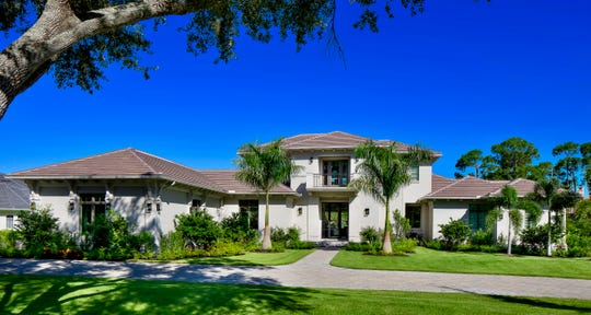 The Casa Bordolino model, by Stock Custom Homes, overlooks the 1st green of the community's Preserve Course.
