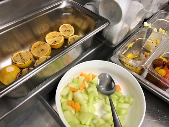 Grilled lemons, chopped melon and other garnishes are all part of the self-serve lunch for Hamilton Harbor Yacht Club employees.