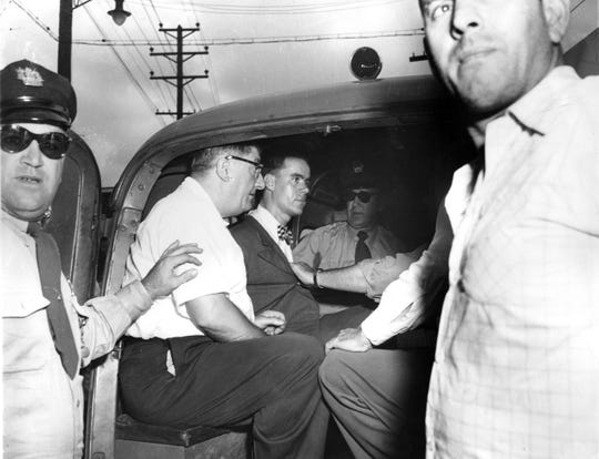 An emotionless Howard Unruh sits in a squad car surrounded by police in this 1949 photo. Unruh was convicted in the deadliest, one-man massacre in the history of Camden after going on a rampage that left 13 dead and 3 wounded. It is believed that the former Army vet snapped after an argument with neighbors over a missing backyard fence.