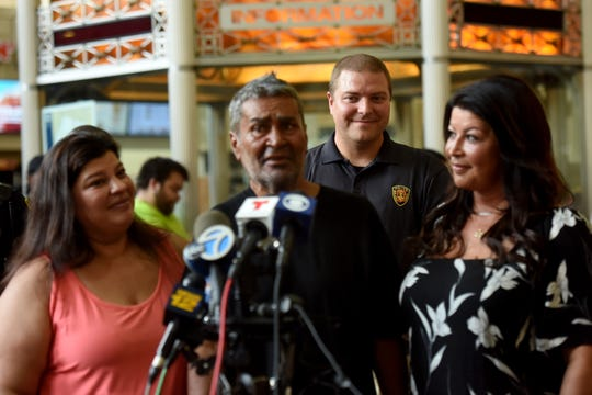 NJ Transit Crisis Outreach Officer Sean Pfeifer, back, reunited a homeless Jose Lopez, 61 with his daughters, Angela Viviani, on left, and Kristy Viviani, after twenty-four years on August 16, 2019. Lopez was discovered in Secaucus Junction Station in early August. Lopez and his two daughters, Kristy and Angela Viviani attend a press conference at Newark Penn Station on August 20, 2019.