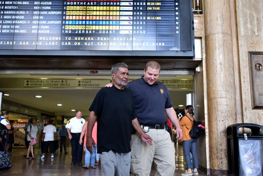 NJ Transit Crisis Outreach Officer Sean Pfeifer reunited a homeless Jose Lopez, 61 with family he hadn't seen in twenty-four years on August 16, 2019. Lopez was discovered in Secaucus Junction Station in early August. Lopez and his two daughters, Kristy and Angela Viviani attend a press conference at Newark Penn Station on August 20, 2019.
