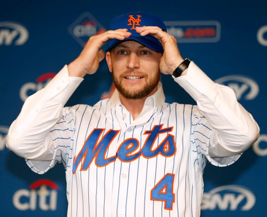 New York Mets All-Star infielder Jed Lowrie adjusts his cap after he was introduced to the media during a press conference after singing with the Mets, Wednesday, Jan. 16, 2019, in New York. (AP Photo/Kathy Willens)