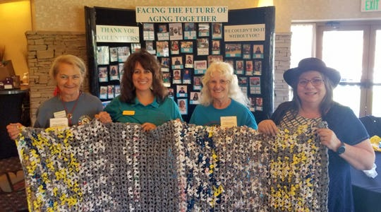 The Deming Senior Center's Retired Senior Volunteer Program (RSVP) volunteers made a presentation during the 41st New Mexico Conference on Aging, Aug. 13-14,in Albuquerque. The volunteers were invited by the NM Aging and Long Term Services Senior Services Bureau Chief, Kimberly Ulibarri to demonstrate the Homeless Mattress Pad Project. The volunteers take recycled plastic bags and crochet them into mattress or tote bags for the homeless in Deming and Luna County. Several senior programs expressed interest in starting their own Homeless Mattress Pad Project at their facilities. Pictured from left are: Susan Kyle, RSVP volunteer; Ulibarri, senior services bureau chief; Winter Vanceunebrock, RSVP volunteer; Julie Bolton, Deming Senior Center executive director.