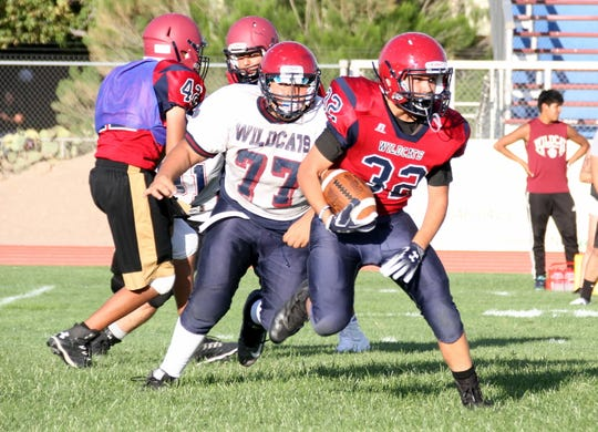 The Deming High Cardinal-Navy Scrimmage kept most of its offensive arsenal in check during Friday night's practice run at DHS Memorial Stadium.