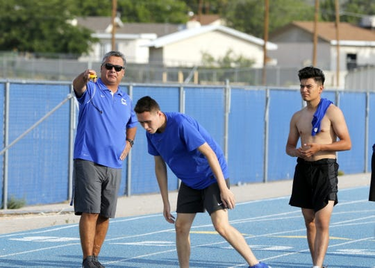 Steve Garza instructs Matt Fernandez during PE at Carlsbad High. Garza returns to coach the boys basketball team this year after spending the last 15 years coaching middle school and being a father.