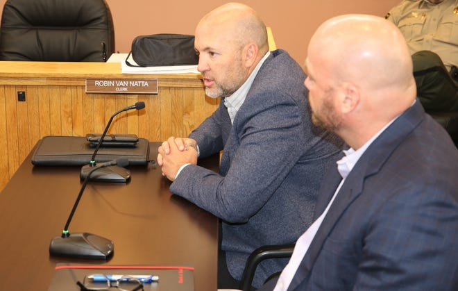 (From left) New Mexico Department of Transportation Roswell District Engineer Tim Parker looks on as New Mexico Department of Transportation Secretary Michael Sandoval speaks before Eddy County Commissioners Aug. 20.
