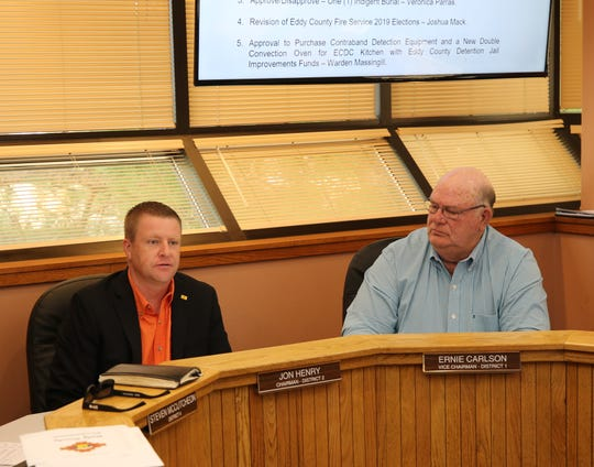 Eddy County Commission Chairperson Jon Henry (left) and Vice Chairperson Ernie Carlson address New Mexico Department of Transportation officials Aug. 20 in Carlsbad.