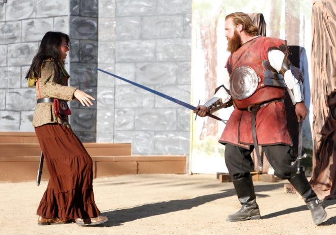 "Kiana Poafpybitty and Tom Jennings are featured in the Theater Ensemble Arts production of ""Robin Hood"" continuing this weekend at the Lions Wilderness Park Amphitheater in Farmington."
