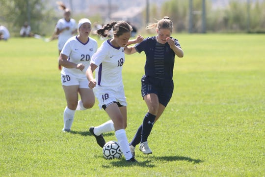 Kylie Haws of Kirtland Central keeps control of the ball against Anna Graven of Piedra Vista during a soccer match on Saturday, Aug. 17, 2019 at PVHS. Visit daily-times.com for the latest sports results, images and highlights.