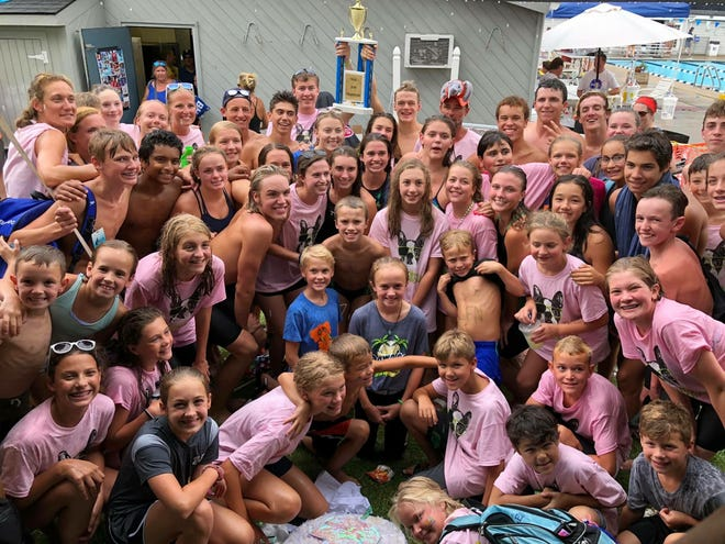 The Farmington Glen Swim Club poses with their trophy after defeating Forest Hills at the 2019 NSSL Championships.