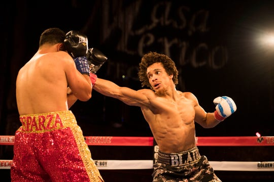Blair Cobbs (right) throws a punch at Mario Esparza during their bout in Los Angeles on March 16, 2018.