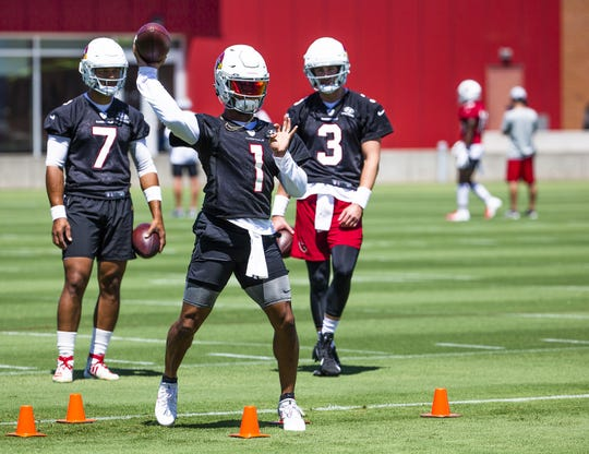 Arizona Cardinals quarterbacks Brett Hundley, left, Kyler Murray and Drew Anderson run drills during practice in Tempe, Tuesday, August 20, 2019.