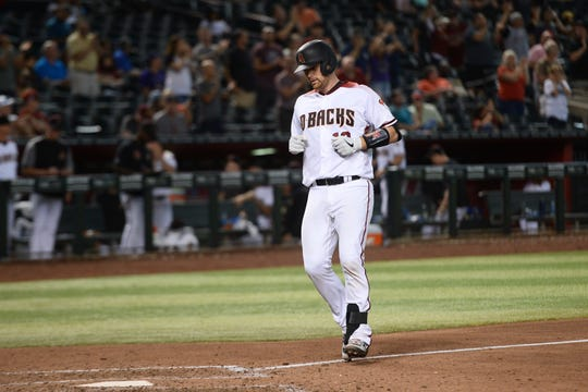 Aug 19, 2019: Arizona Diamondbacks catcher Carson Kelly (18) approaches home plate after hitting a solo home run against the Colorado Rockies during the eighth inning at Chase Field.