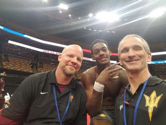 Kiwan Watts, center, with ASU gymnastics coaches Rob Survick, left, and Scott Barclay at the recent U.S. Gymnastics Championships. Watts was silver medalist on vaulting.