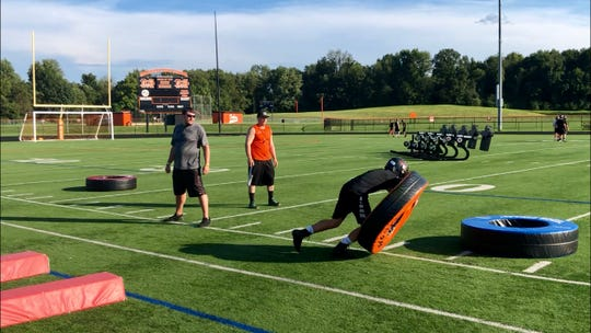 Marlboro football players go through agility and tackling drills during their Aug. 19 practice.