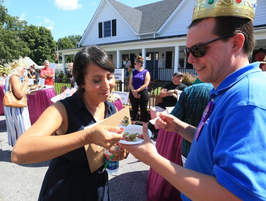 From left, Carolyn Haines of Poughkeepsie and Mark Mallone of Poughquag judging food from the Sport Run food contest for Rhinebeck Bank at the 2019 Dutchess County Fair in Rhinebeck on August 20, 2019.