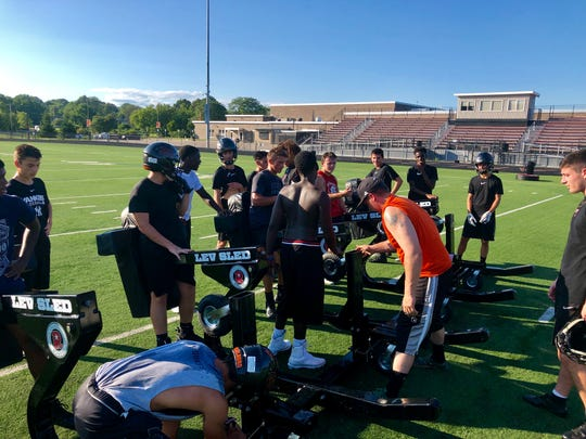 A group of Marlboro football players ready to push the blocking sled during their Aug. 19 practice.