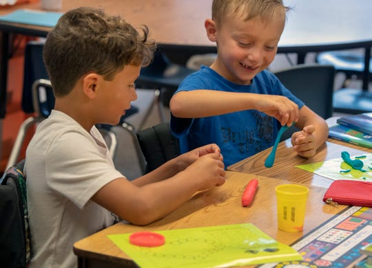 Hayden Grimm, left, and Nicholas Zink get to know each other in their first-grade class during the opening moments of the first full day at North Salem Elementary School in the Dover Area School District.