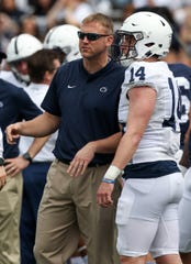 Penn State offensive coordinator Ricky Rahne, left, said Sean Clifford, in his limited time playing last year, showed he has confidence.