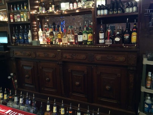 The back bar at 9 One One Tavern originally was located in the Westcott Hotel at 10th and Main streets.