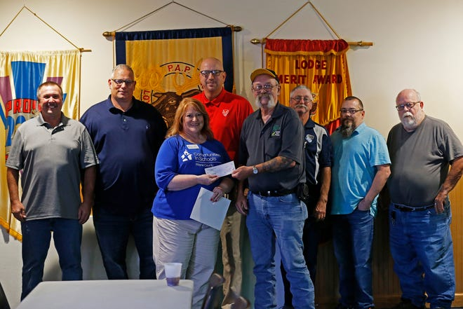 Members of Richmond's Moose Lodge 167 present a donation of $5,000 to Communities in Schools Executive Director Becky Murray (third from left).