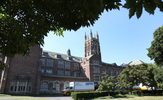 Moving trucks line the drive way to the Colgate Rochester Crozer Divinity School as the campus prepares to move into the Village Gate.